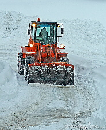 Free Orange Snow Plow Clears The Streets Stock Photo - 23183950