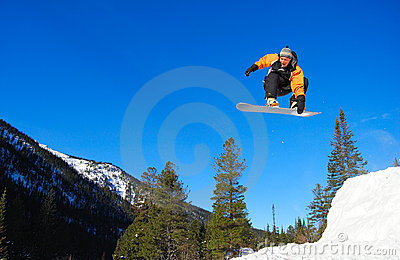 Orange snowboarder jumping high