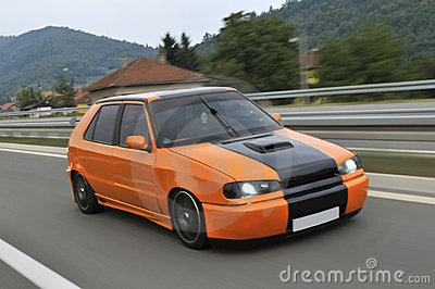 Orange sport car drive fast