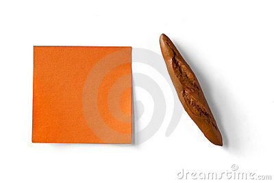 Orange sticky note and figure of french loaf