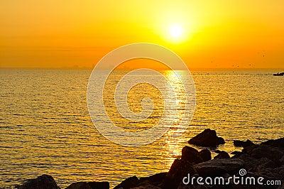 Orange sunrise in sea