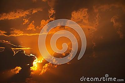 Orange sunset in clouds