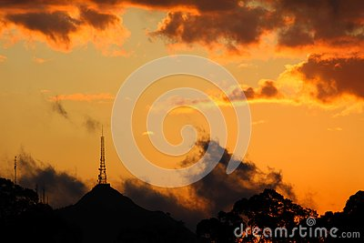 Orange sunset with rain and clouds of several colors Stock Photo