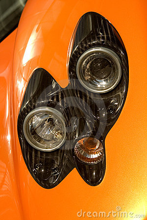 Free Orange Supercar Headlights Royalty Free Stock Photography - 5595617