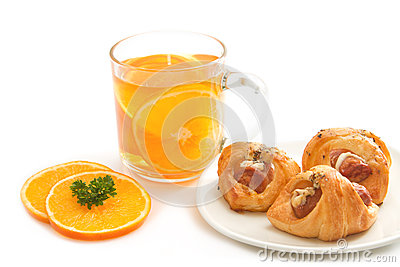Orange tea with little  croissant