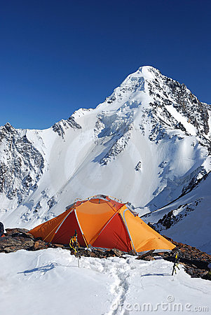 Orange tent in mountains