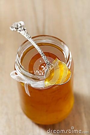 Orange   thin cut marmalade or jam on a spoon