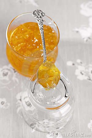 Orange thin cut marmalade or jam on a spoon