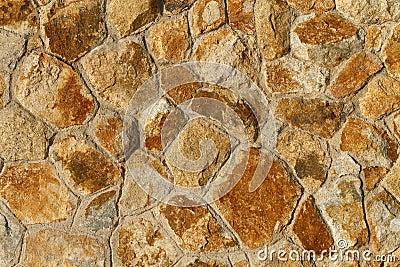 Orange tinted stone wall background