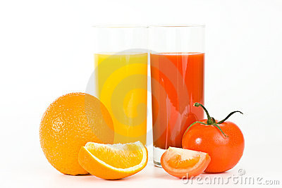 Orange and tomato fruits with juice in the glass,