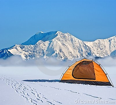 Orange touristic tent in a mountains