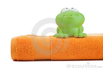 Orange towel and toy frog