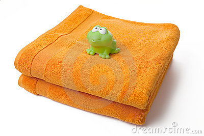 Orange towels and toy frog