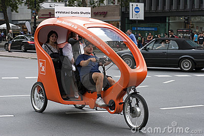 Orange velotaxi in Berlin Editorial Stock Image