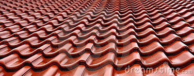 Orange wet roof tiles