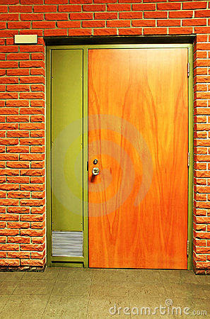 Orange wooden door and bricks