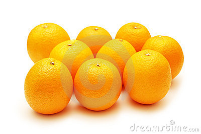 Oranges arranged in rows and isolated on white