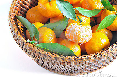 Oranges in basket  isolated