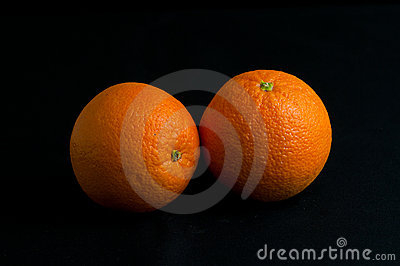 Oranges isolated on black