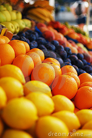 Oranges and lemons at a market stand