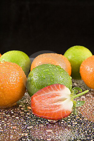 Oranges limes and strawberry