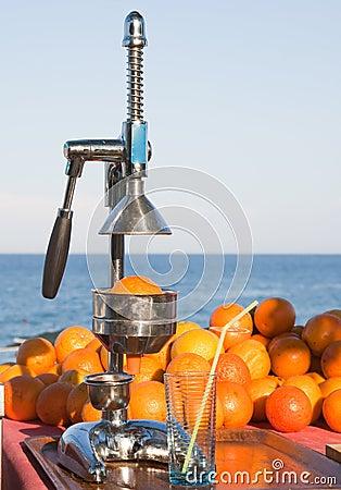 Oranges and manual press