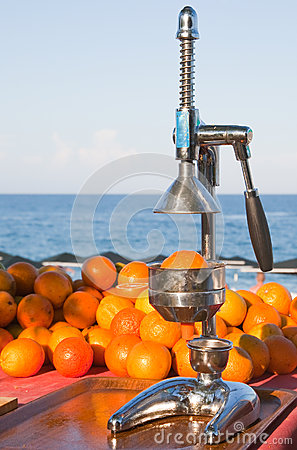 Oranges and manual press
