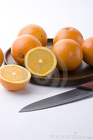 Oranges, wooden tray and a fruit knife