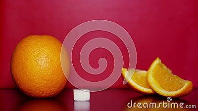 Oranje en witte suiker stock videobeelden