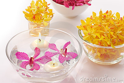 Orchid in bowl and candle