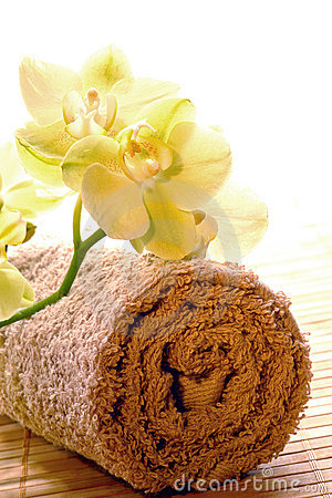 Orchid Flowers on Brown Cotton Towel in a Spa