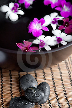 Orchids in bowl for an oriental spa