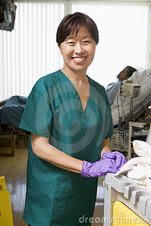 An Orderly Cleaning A Hospital Ward