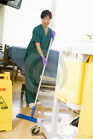 An Orderly Mopping The Floor In A Hospital