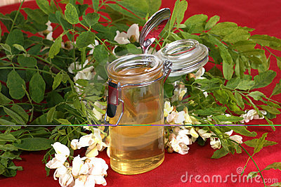 organic acacia honey in a small glass