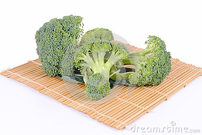 Organic broccoli on a bamboo placemat
