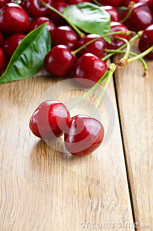 Organic Cherries on the wooden table