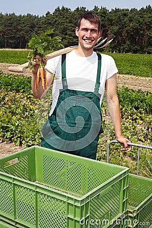 Organic famer smiling on field