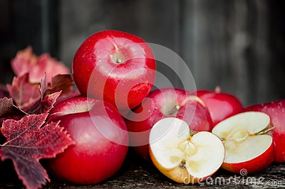 Organic fresh apples on wooden background in autum