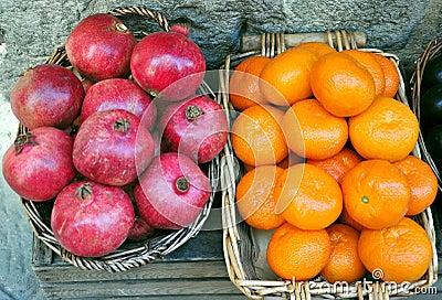 Organic market: pomegranate and orange
