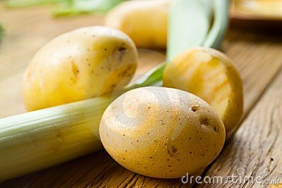 Organic potato on wood - selective focus