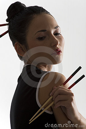 Oriental girl with chopstick