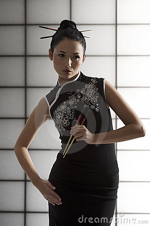 Free Oriental Girl With Chopstick Stock Photo - 12358690