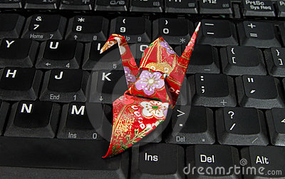 Origami on a laptop keyboard