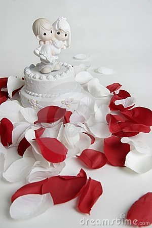 Ornament of groom carrying bride surrounded by rose petals