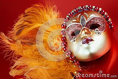 Ornate carnival mask on red background
