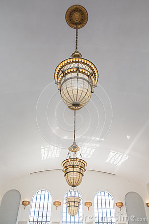 Ornate Old Lamps Hanging From White Ceiling Stock Photo