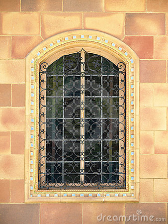 Ornate Window with wrought iron bars
