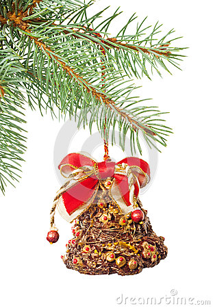 Ornate Xmas bell on fir twig isolated on white