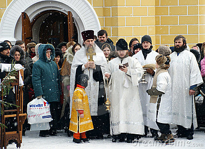 Orthodox Christians participate in a Christening Editorial Stock Image